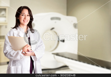 Female doctor radiologist at CT CAT scan with chart stock photo, Beautiful happy female doctor physician radiologist holding patient medical chart and pen standing in CT CAT Scan room at hospital, isolated. by Paul Hakimata
