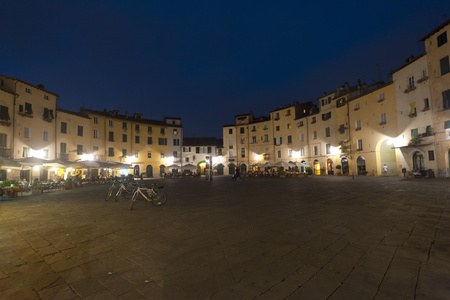 Lucca, Piazza Anfiteatro by night stock photo, Lucca (Tuscany, Italy), Piazza Anfiteatro, historic square, by night by clodio
