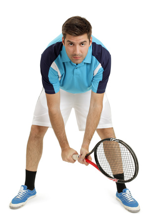 Male tennis player stock photo, Photo of an attractive male tennis player waiting for the serve.  Full body shot with slight shadow around shoes. by &copy; Ron Sumners