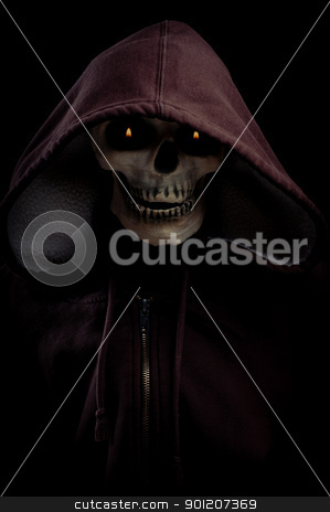 Skeleton hoodie with flaming eyes stock photo, A Skeleton Wearing hoodie with flaming eyes.  Good dark image for Halloween  by Robby Ticknor
