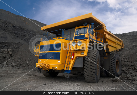 Photo of the big mine truck. stock photo, A picture of a big yellow mining truck at worksite. by miloslav78