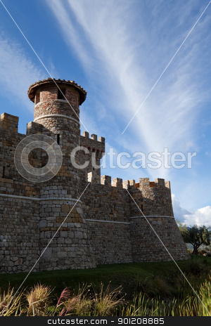 Stone Castle stock photo, A stone castle with hilly mountains in the background by Kevin Tietz