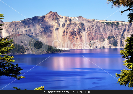 Wizard Island Crater Lake Reflection Blue Pink Reflection Oregon stock photo, Pink Blue Crater Lake Reflection, Wizard Island, Blue Sky Oregon Pacific Northwest by William Perry