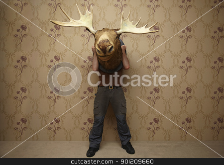 man is hiding stock photo, man is hiding behinde a moose head by sielemann