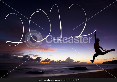 happy new year 2012 stock photo, happy new year 2012. young man jumping and drawing 2012 by flashlight in the air on the beach before sunrise by tomwang