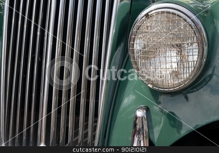 Touch of class stock photo, old antique car grill with headlight stone grill by Jack Schiffer