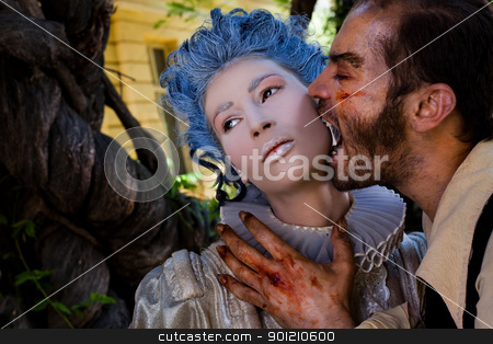Male vampire zombie biting woman  stock photo, Male vampire with wounds biting young woman in medieval dress  by vilevi