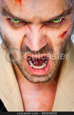 zombie scary eyes stock photo, Portrait of sinister man wolf with scary green artificial eyes, mouth open by vilevi