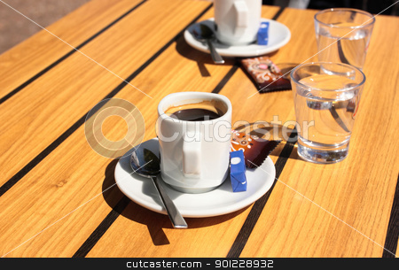 cups of coffee with a glass of water stock photo, cups of coffee with a glass of water by Chretien