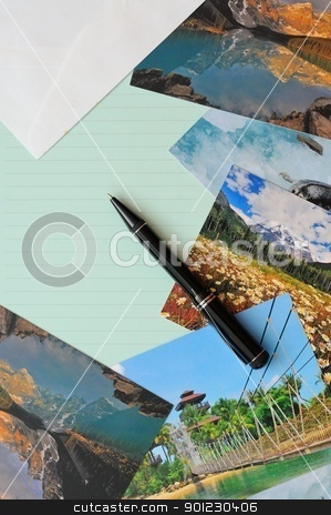 Empty letter pad with scenic postcards stock photo, Empty letter pad and pen with scenic postcards in background. by Wai Chung Tang