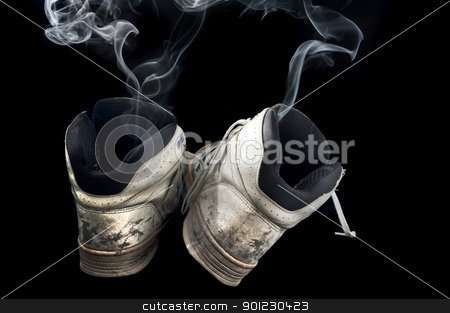 stinky sneakers stock photo, pair of rotten old sneakers on a black background by Stephen Gibson
