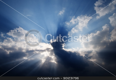 Sunbeams in the sky stock photo, Sunbeams in a cloudy sky by Dutourdumonde