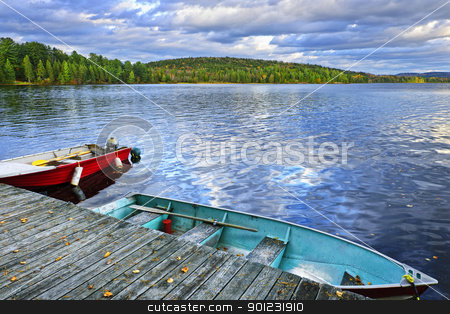 Rowboats on lake at dusk stock photo, Rowboats docked on Lake of Two Rivers in Algonquin Park, Ontario, Canada by Elena Elisseeva