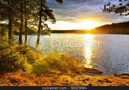 Sunset over lake stock photo, Sunset over Lake of Two Rivers in Algonquin Park, Ontario, Canada by Elena Elisseeva