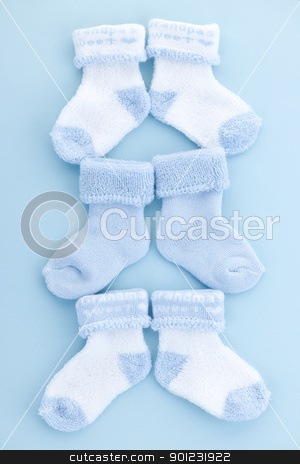 Blue baby socks stock photo, Arrangement of three pairs of blue infant boy socks for baby shower by Elena Elisseeva