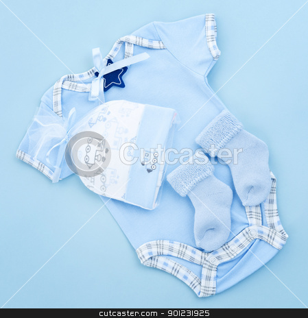 Blue baby clothes for infant boy stock photo, Blue infant boy clothing for baby shower by Elena Elisseeva