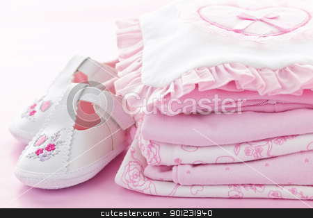 Pink baby clothes for infant girl stock photo, Pink infant girl clothing and shoes for baby shower by Elena Elisseeva