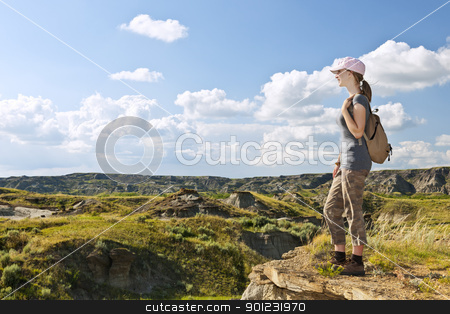 Hiker in badlands of Alberta, Canada stock photo, Girl looking at scenic view of the Badlands in Dinosaur provincial park, Alberta, Canada by Elena Elisseeva