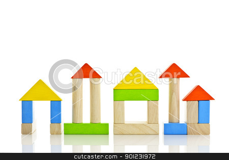 Wooden blocks buildings stock photo, Buildings constructed out of toy wooden building blocks by Elena Elisseeva