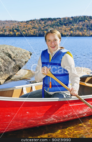 Girl in canoe stock photo, Teen girl canoeing on Lake of Two Rivers, Ontario, Canada by Elena Elisseeva