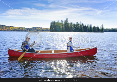 Family canoe trip stock photo, Family canoeing on sunny Lake of Two Rivers, Ontario, Canada by Elena Elisseeva