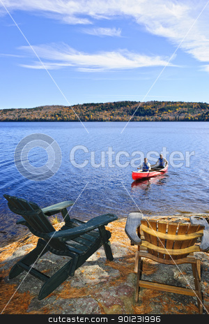 Canoeing on lake stock photo, People returning from canoe trip on Lake of Two Rivers, Ontario, Canada by Elena Elisseeva
