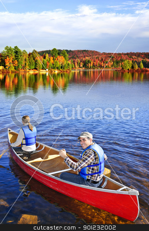 Canoing in fall stock photo, People canoeing on scenic lake in fall, Algonquin park, Canada by Elena Elisseeva