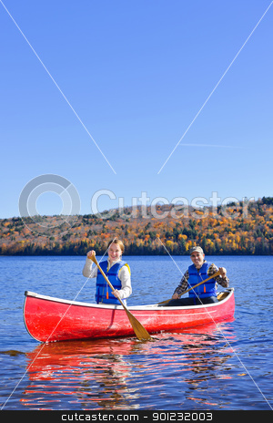 Canoe trip on scenic lake in fall stock photo, Family canoeing on Lake of Two Rivers, Ontario, Canada by Elena Elisseeva