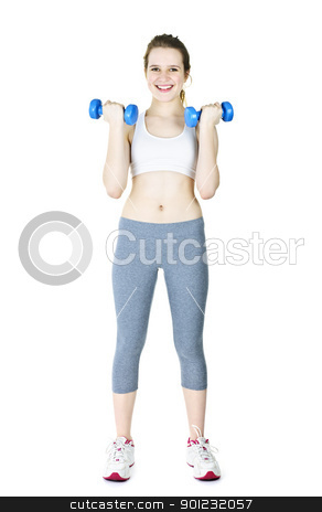 Happy active girl holding weights stock photo, Happy fit young woman working out with weights standing on white background by Elena Elisseeva