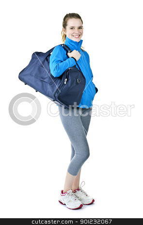 Athletic girl with gym bag ready for workout stock photo, Happy fit young woman with gym bag standing ready for fitness exercise by Elena Elisseeva