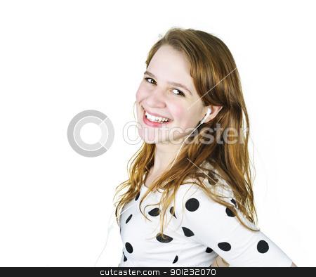 Teenage girl listening to music stock photo, Isolated portrait of beautiful teenage girl listening to music with earphones by Elena Elisseeva