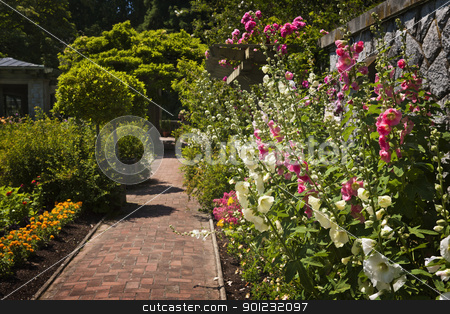 Colorful flower garden stock photo, Lush summer garden with paved path and blooming flowers by Elena Elisseeva