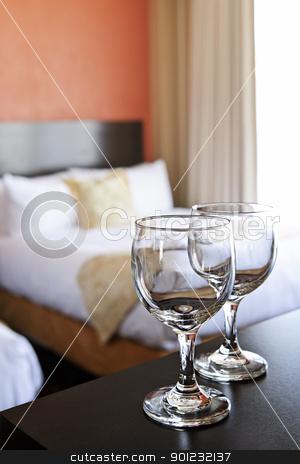Wineglasses in hotel room stock photo, Romantic bedroom with wine glasses in luxury hotel interior by Elena Elisseeva