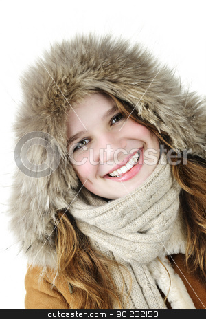 Smiling winter girl stock photo, Beautiful young woman in fur hood of winter coat on white background by Elena Elisseeva