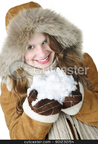 Playful winter girl holding snow stock photo, Playful young woman in winter coat with fur hood holding pile of fresh snow by Elena Elisseeva