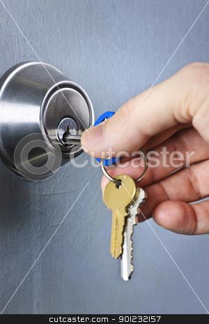 Hand inserting keys in lock stock photo, Hand inserting keys in door lock close up by Elena Elisseeva