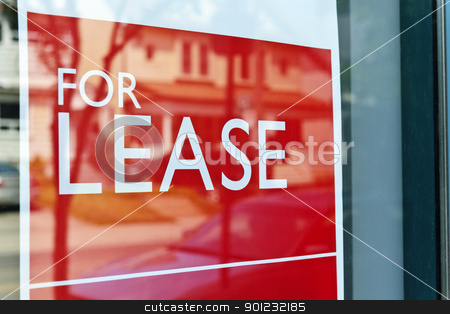 For lease sign stock photo, For Lease sign on red in window reflecting street scene by Elena Elisseeva
