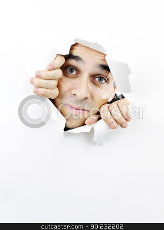 Face looking through hole in paper stock photo, Curious man looking through hole torn in white paper by Elena Elisseeva