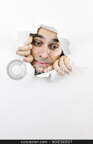Face looking through hole in paper stock photo, Hole in paper with frightened man looking down through by Elena Elisseeva