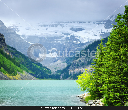 Lake Louise with mountains stock photo, Landscape of beautiful Lake Louise and mountains in Alberta, Canada by Elena Elisseeva