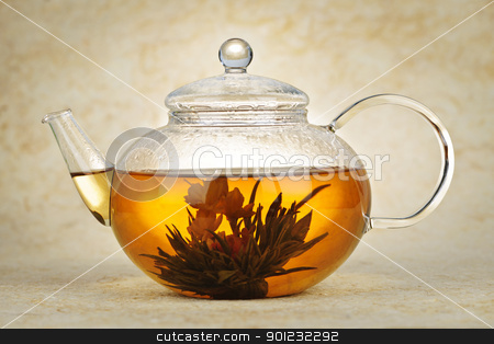 Flowering blooming tea stock photo, Flowering blooming green tea in glass teapot by Elena Elisseeva