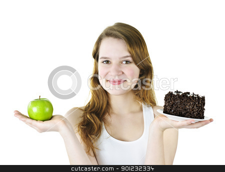Young girl holding apple and cake stock photo, Smiling young woman holding apple and chocolate cake by Elena Elisseeva