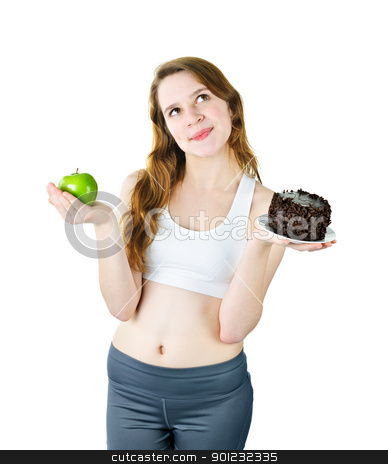 Young girl holding apple and cake stock photo, Tempted young woman holding apple and chocolate cake making a choice by Elena Elisseeva