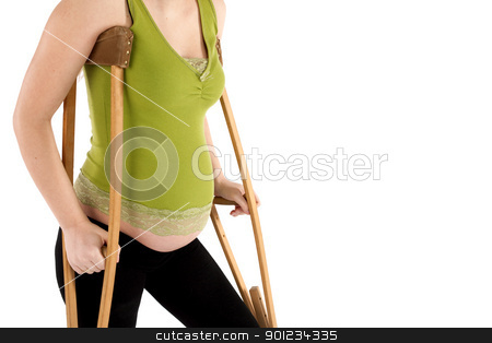 Pregnant Woman with Crutches stock photo, Nine month pregnant woman  with crutches close-up, isolated on white background by Rognar