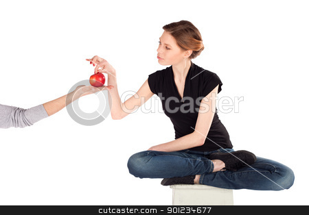 Slim Woman on Diet stock photo, Slim woman on diet taking red apple from a man's hand isolated against white background by Rognar