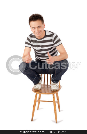 Happy Man Showing OK Sign stock photo, Smiling handsome young man sitting on chair gesturing ok sign isolated against white background  by Rognar