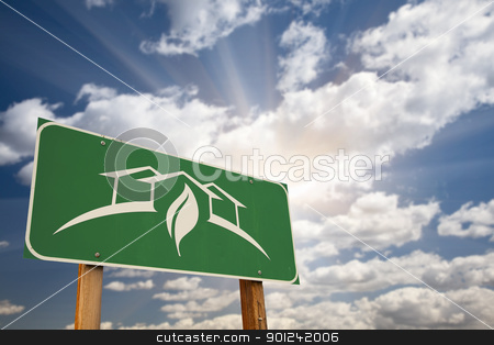 Green House Design Road Sign stock photo, Green House Design Green Road Sign Against Dramatic Sky, Clouds and Sunburst. by Andy Dean