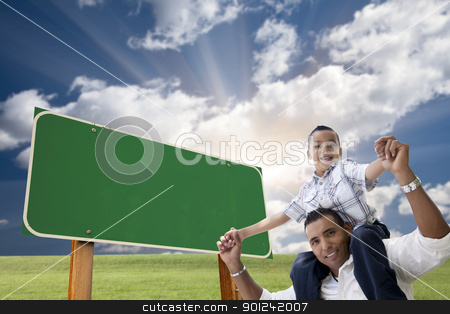 Father and Son in Front of Blank Green Road Sign stock photo, Attractive Happy Hispanic Father and Son in Front of Blank Green Road Sign Ready for Your Own Message. by Andy Dean