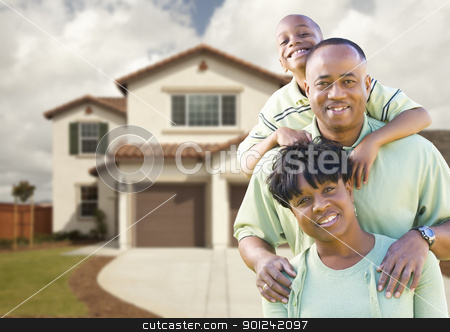 Attractive African American Family in Front of Home stock photo, Attractive African American Family in Front of Beautiful House. by Andy Dean