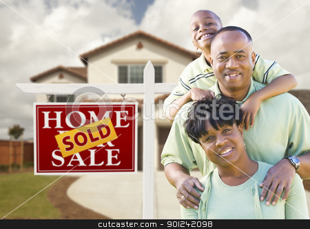 African American Family, House and Sold Sign stock photo, Happy African American Family in Front of New House and Sold Real Estate Sign. by Andy Dean